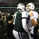 Miami Dolphins quarterback Ryan Tannehill (17) greets New York Jets quarterback Geno Smith (7) after the Dolphins won 16-13 in an NFL football game, Monday, Dec. 1, 2014, in East Rutherford, N.J The Associated Press