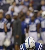 Indianapolis Colts' Adam Vinatieri (4) kicks a 37-yard field goal out of the hold of Pat McAfee during the first half of an NFL football game against the Tennessee Titans Sunday, Dec. 1, 2013, in Indianapolis. (AP Photo/Michael Conroy)
