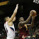 Cleveland Cavaliers shooting guard Dion Waiters (3) goes up for a basket as Atlanta Hawks forward Gustavo Ayon defends in the second half of an NBA basketball game Friday, Dec. 6, 2013, in Atlanta The Associated Press