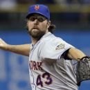 New York Mets starting pitcher R.A. Dickey delivers to the Tampa Bay Rays during the first inning of an interleague baseball game Wednesday, June 13, 2012, in St. Petersburg, Fla. (AP Photo/Chris O'Meara)