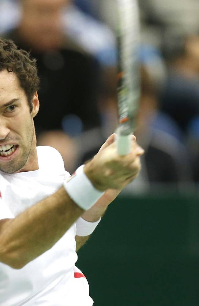 Kazakhstan's Mikhail Kukushkin returns a ball to France's Richard Gasquet during the final match at the Kremlin Cup tennis tournament in Moscow, Russia, Sunday, Oct. 20, 2013
