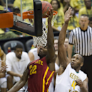 Iowa State forward Dustin Hogue (22) shoots a layup as George Mason center Erik Copes (4) defends during the first half of an NCAA college basketball game at the Diamond Head Classic on Sunday, Dec. 22, 2013, in Honolulu. (AP Photo/Eugene Tanner)