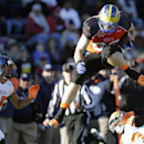 Delaware tight end Nick Boyle (86) jumps over UCLA safety Anthony Jefferson during an NCAA college football game at the Senior Bowl, Saturday, Jan. 24, 2015, in Mobile, Ala. (AP Photo/Brynn Anderson)