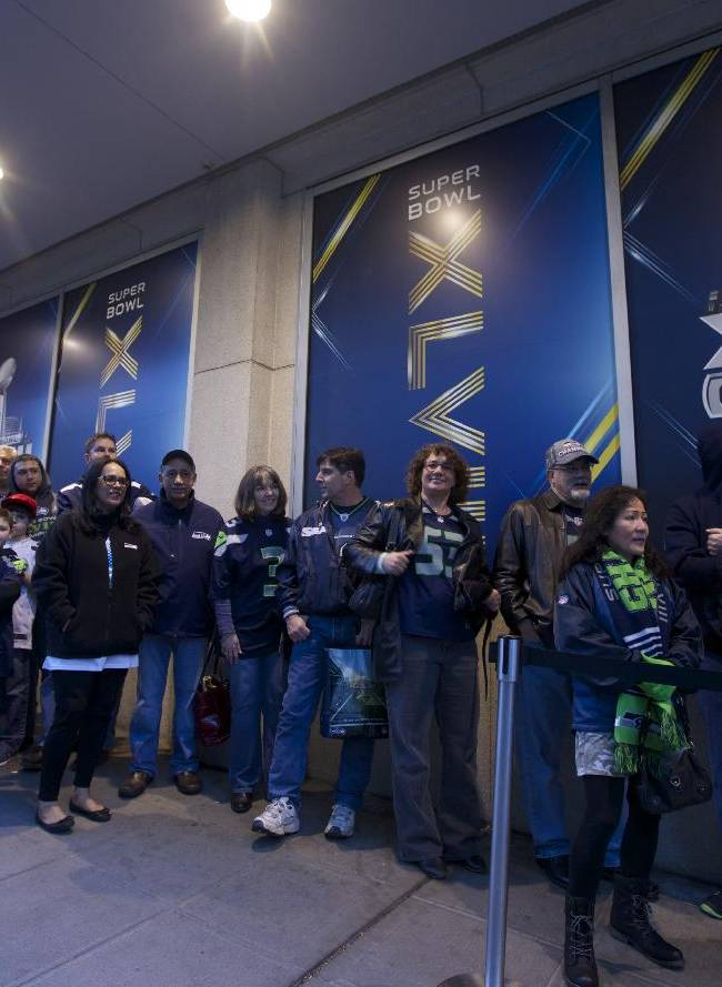 Fans wait in line outside a movie theater before the premiere of NFL Films'