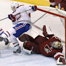 Montreal Canadiens' Brendan Gallagher, left, collides with Phoenix Coyotes' Mike Smith during the third period of an NHL hockey game Thursday, March 6, 2014, in Glendale, Ariz. The Coyotes defeated the Canadiens 5-2 The Associated Press