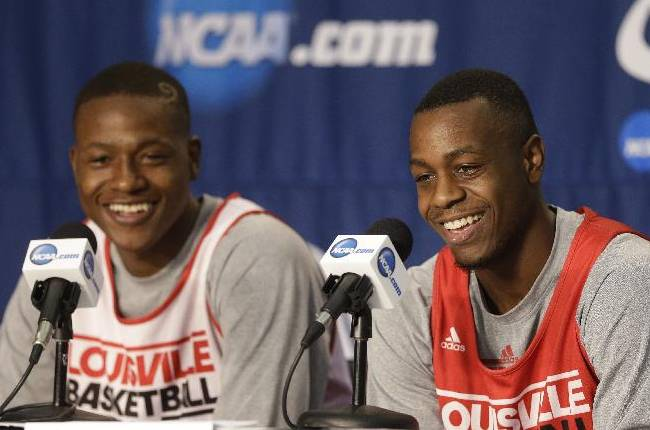 Louisville guards Terry Rozier, left, and Chris Jones, smile during a news conference at at the NCAA mens college basketball tournament Friday, March 21, 2014, in Orlando, Fla. Louisville will play Saint Louis in the third-round game on Saturday