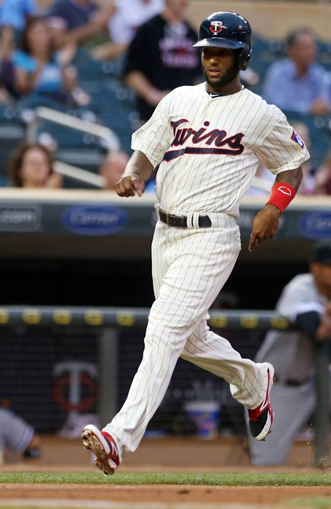 Twins' Santana leaves game with back injury