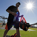 Baltimore Orioles' Nelson Cruz walks to the dugout after taking batting practice before an exhibition spring training baseball game against the Toronto Blue Jays in Sarasota, Fla., Saturday, March 1, 2014 The Associated Press