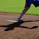 New York Mets pitcher Dillon Gee casts a shadow as he throws off a mound during spring training baseball practice Friday, Feb. 14, 2014, in Port St. Lucie, Fla The Associated Press