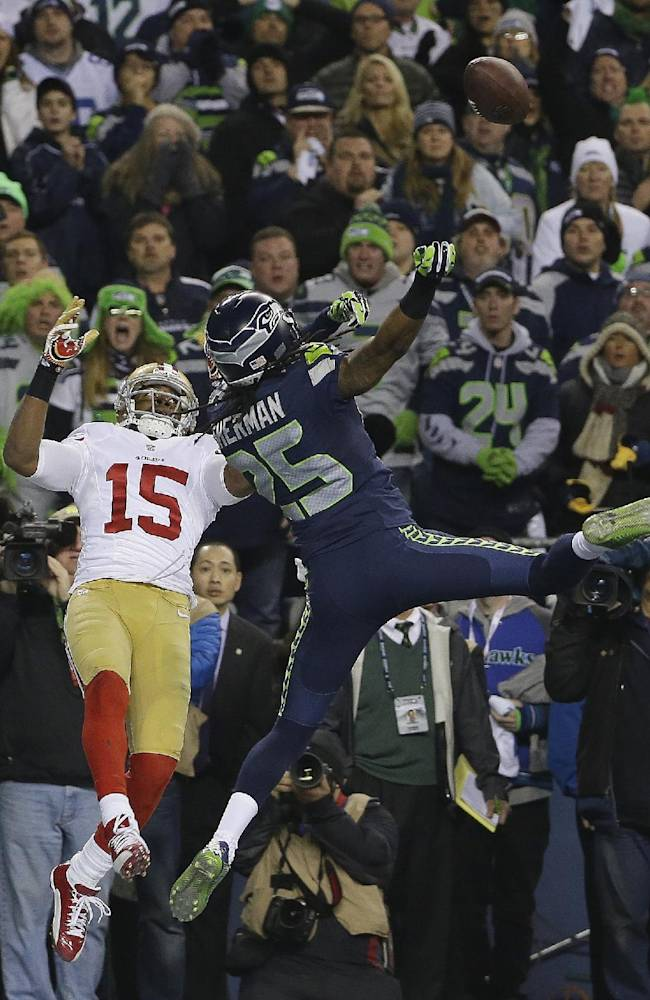 Seattle Seahawks' Richard Sherman tips a pass intended for San Francisco 49ers' Michael Crabtree (15) in the final seconds of the second half of the NFL football NFC Championship game Sunday, Jan. 19, 2014, in Seattle. Malcolm Smith intercepted the tipped pass. The Seahawks won 23-17 to advance to Super Bowl XLVIII