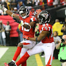 Atlanta Falcons wide receiver Roddy White, right, celebrates with Harry Douglas after setting the franchise record with his 62nd touchdown reception during tyhe NFL football game against the Pittsburgh Steelers on Sunday, Dec. 14, 2014, in Atlanta. (AP