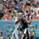 Miami Dolphins cornerback Cortland Finnegan (24) defends New England Patriots wide receiver Julian Edelman (11) during the first half of an NFL football game in Miami Gardens, Fla., Sunday, Sept. 7, 2014 The Associated Press