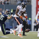Chicago Bears' Brandon Marshall (15) can't hold on to the ball as quarterback Jay Cutler (6) watches and Seattle Seahawks' Brock Coyle defends in the first half of a preseason NFL football game, Friday, Aug. 22, 2014, in Seattle The Associated Press