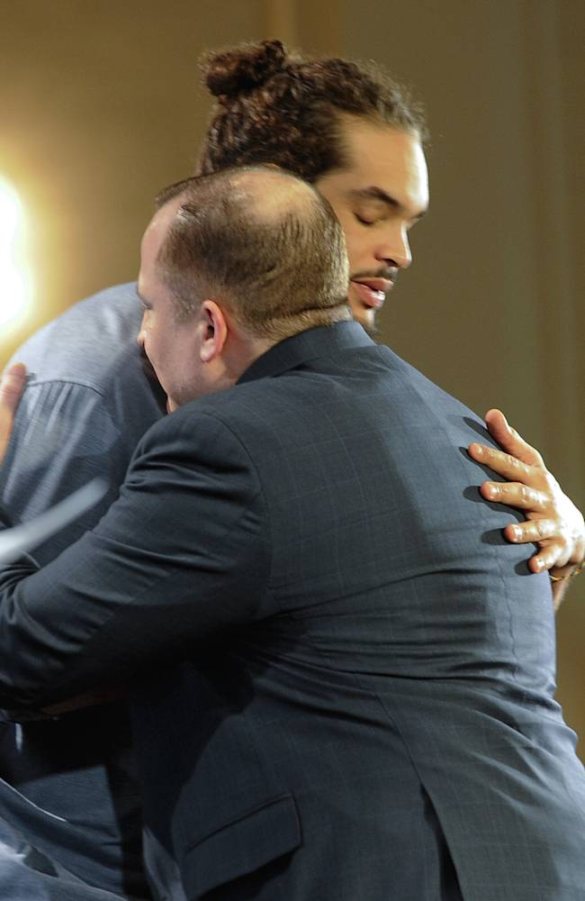 Chicago Bulls center Joakim Noah, hugs coach Tom Thibodeau after being named the NBA's Defensive Player of the Year, Monday, April 21, 2014, in Lincolnshire, Ill