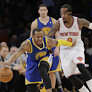 Golden State Warriors' Andre Iguodala (9) protects the ball from New York Knicks' J.R. Smith (8) during the first half of an NBA basketball game on Friday, Feb. 28, 2014, in New York The Associated Press