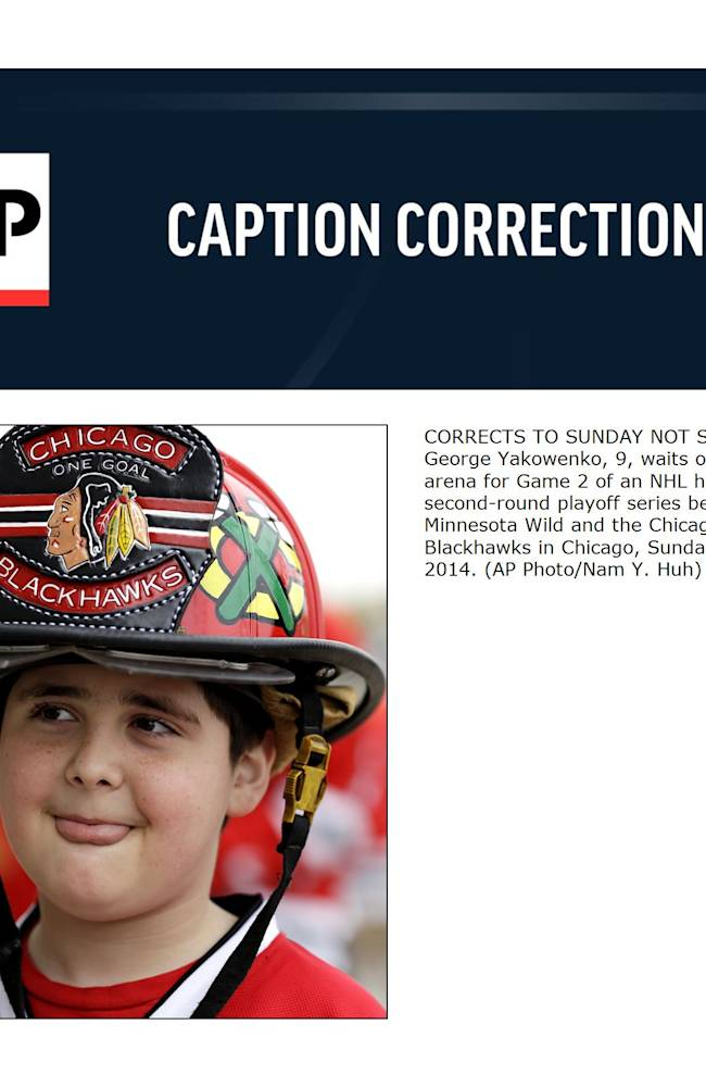 CORRECTS TO SUNDAY NOT SATURDAY - George Yakowenko, 9, waits outside of arena for Game 2 of an NHL hockey second-round playoff series between the Minnesota Wild and the Chicago Blackhawks in Chicago, Sunday, May 4, 2014