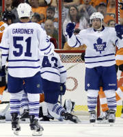 Toronto Maple Leafs' Phil Kessel, second from right, reacts with teammate Jake Gardiner after scoring a goal during the second period of an NHL hockey game against the Philadelphia Flyers, Wednesday, Oct. 2, 2013, in Philadelphia. (AP Photo/Matt Slocum)