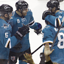 San Jose Sharks' Tyler Kennedy (81), front, celebrates with teammates, from left, Jason Demers (5), Joe Pavelski (8), and Marty Havlat (9), after scoring a goal against the New Jersey Devils during the first period of an NHL hockey game, Saturday, Nov. 23