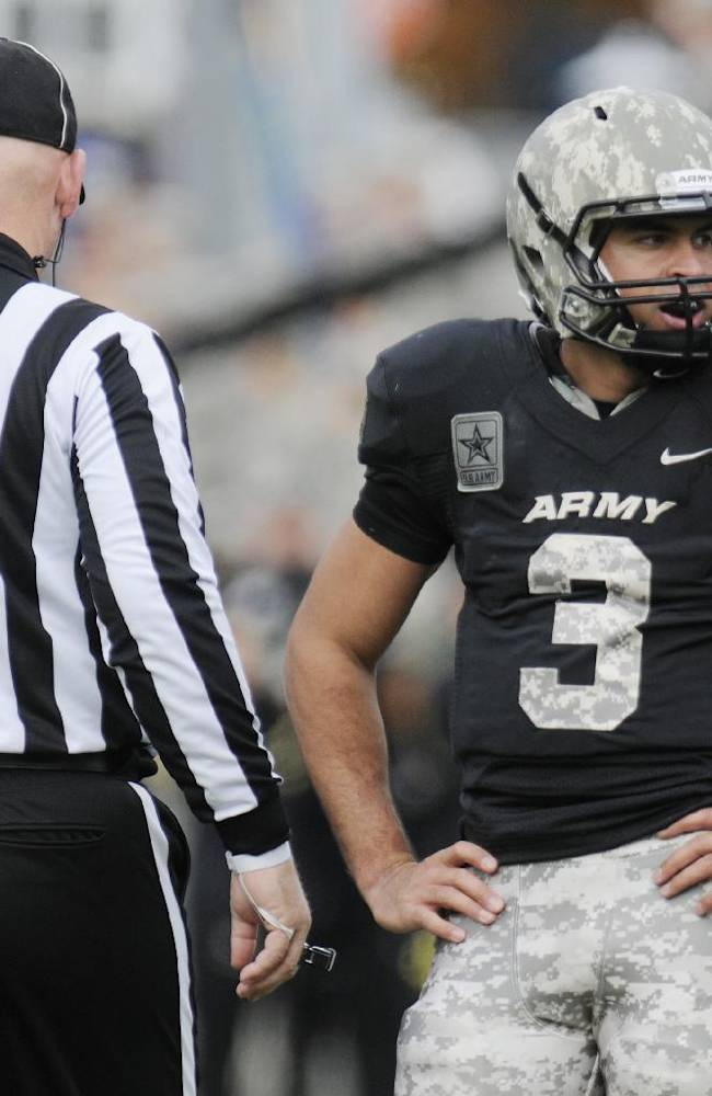 Army quarterback Angel Santiago (3) talks with an official while playing Western Kentucky during the second half of an NCAA college football game Saturday, Nov. 9, 2013, in West Point, N.Y