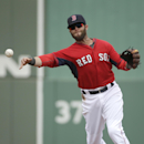 Boston Red Sox second baseman Dustin Pedroia throws to first base to retire Northeastern's Jason Vosler in the third inning of an exhibition baseball game Thursday, Feb. 27, 2014, in Fort Myers, Fla The Associated Press