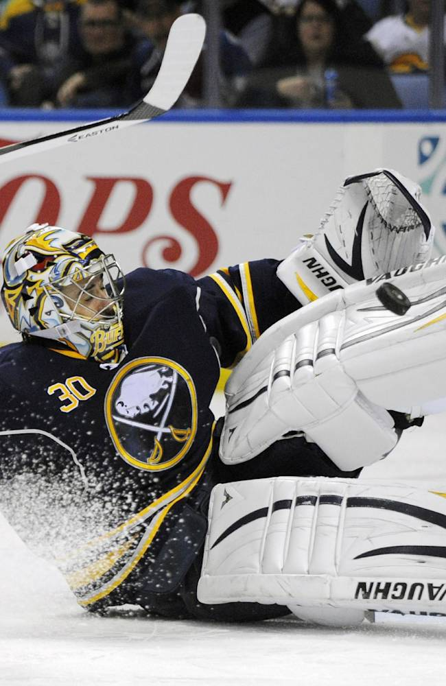 Buffalo Sabres goaltender Ryan Miller makes save on a Colorado Avalanche shot during the second period of an NHL hockey game in Buffalo, N.Y., Saturday, Oct. 19, 2013