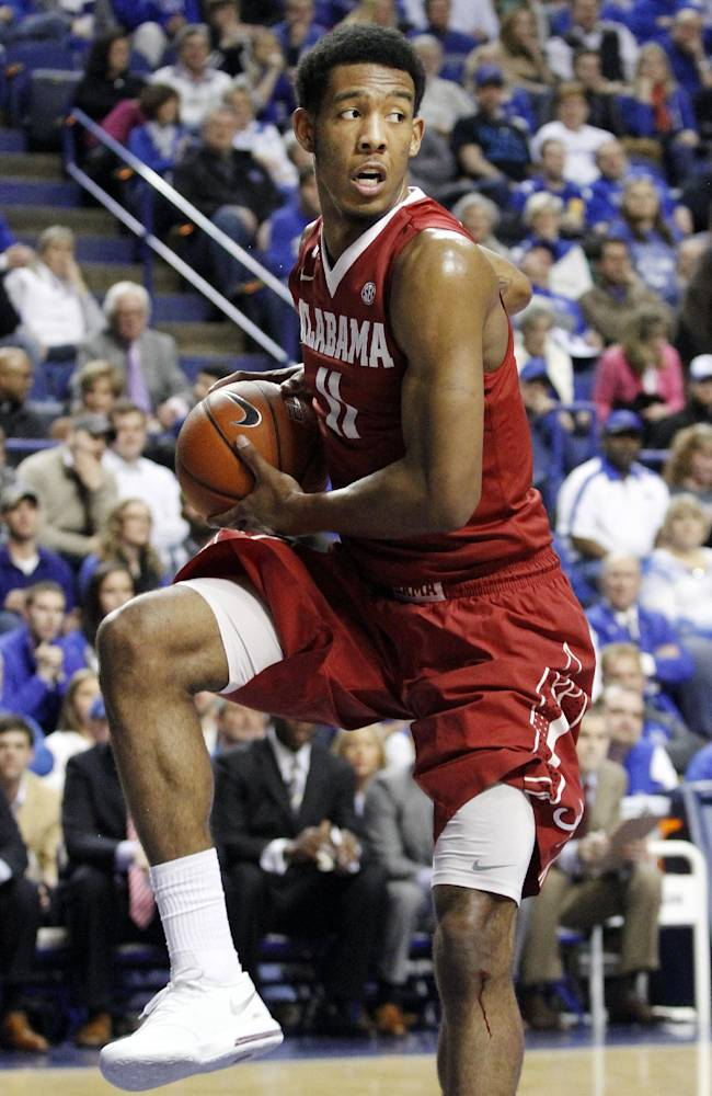 Alabama's Shannon Hale pulls down a rebound during the first half of an NCAA college basketball game against Kentucky, Tuesday, March 4, 2014, in Lexington, Ky