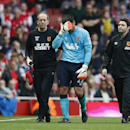 Hull City goalkeeper Steve Harper walks off the pitch escorted by medical staff after an injury which saw him being substituted during the English Premier League soccer match between Arsenal and Hull City at the Emirates stadium in London Saturday, Oct. 1