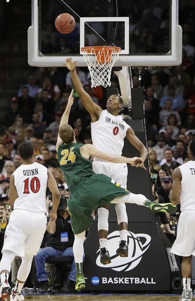 North Dakota State's Taylor Braun (24) shoots against San Diego State's Skylar Spencer (0) in the second half during the third-round game of the NCAA men's college basketball tournament in Spokane, Wash., Saturday, March 22, 2014