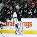 Los Angeles Kings goalie Jonathan Quick skates past his bench after the Kings lost in overtime to the Calgary Flames in an NHL hockey game, Monday, Jan. 19, 2015, in Los Angeles. The Flames won 2-1 The Associated Press