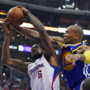 Los Angeles Clippers center DeAndre Jordan, left, puts up a shot as Golden State Warriors forward Marreese Speights defends during the first half in Game 1 of an opening-round NBA basketball playoff series, Saturday, April 19, 2014, in Los Angeles The Ass