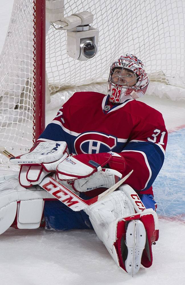 Montreal Canadiens' goaltender Carey Price looks up from his crease after being scored on by the Edmonton Oilers' Ladislav Smid  during the second period of an NHL hockey game in Montreal, Tuesday, Oct. 22, 2013