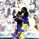 Swansea City's Wilfried Bony, left, celebrates his goal with teammate Marvin Emnes during their English Premier League soccer match against Newcastle United at St James' Park, Newcastle, England, Saturday, April 19, 2014