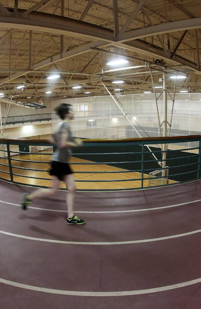 In this photo made with a fisheye lens, a runner uses an indoor track in Vanderbilt's new school's multipurpose facility field house Tuesday, Nov. 5, 2013, in Nashville, Tenn. The track and basketball courts are part of the $31 million addition