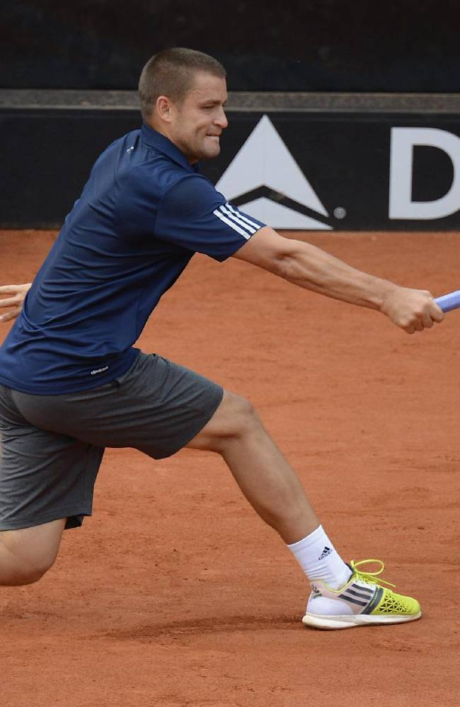 Russia's Mikhail Youzhny  returns a ball to  Czech Republic's  Lukas Rosol, during their semifinal match of the ATP Mercedes Cup tennis tournament in Stuttgart, Germany, Saturday July 12, 2014