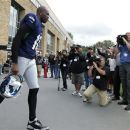 Seattle Seahawks' Terrell Owens heads out to the field during NFL football training camp, Wednesday, Aug. 8, 2012, in Renton, Wash. (AP Photo/Ted S. Warren)