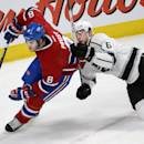Montreal Canadiens right wing Brandon Prust (8) skates around Los Angeles Kings defenceman Jake Muzzin (6) during the first period of an NHL hockey game in Montreal on Tuesday, Dec. 10, 2013. (AP Photo/The Canadian Press, Ryan Remiorz)