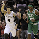 San Antonio Spurs' Danny Green (4) celebrates a three-point shot as he runs back up court with Boston Celtics' Gerald Wallace, right, during the second half of an NBA basketball game, Wednesday, Nov. 20, 2013, in San Antonio The Associated Press
