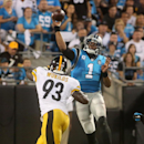 Carolina Panthers quarterback Cam Newton (1) throws the ball as Pittsburgh Steelers' Jason Worilds defefnds during an NFL football game Sunday, Sept. 21, 2014, in Charlotte, N.C The Associated Press