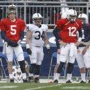 Penn State fullback Dominic Salomone (34) stands between quarterbacks Tyler Ferguson (5) and Steven Bench (12) on the sideline during the first half of their spring NCAA college football game on Saturday, April 20, 2013, in State College, Pa. (AP Photo/Keith Srakocic)