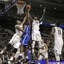 Michigan State forward Adreian Payne, left, and forward Branden Dawson (22) battle with Memphis forward Tarik Black, middle, for a rebound in the first half of their third-round game of the NCAA college basketball tournament in Auburn Hills, Mich., Saturday March 23, 2013. (AP Photo/Paul Sancya)