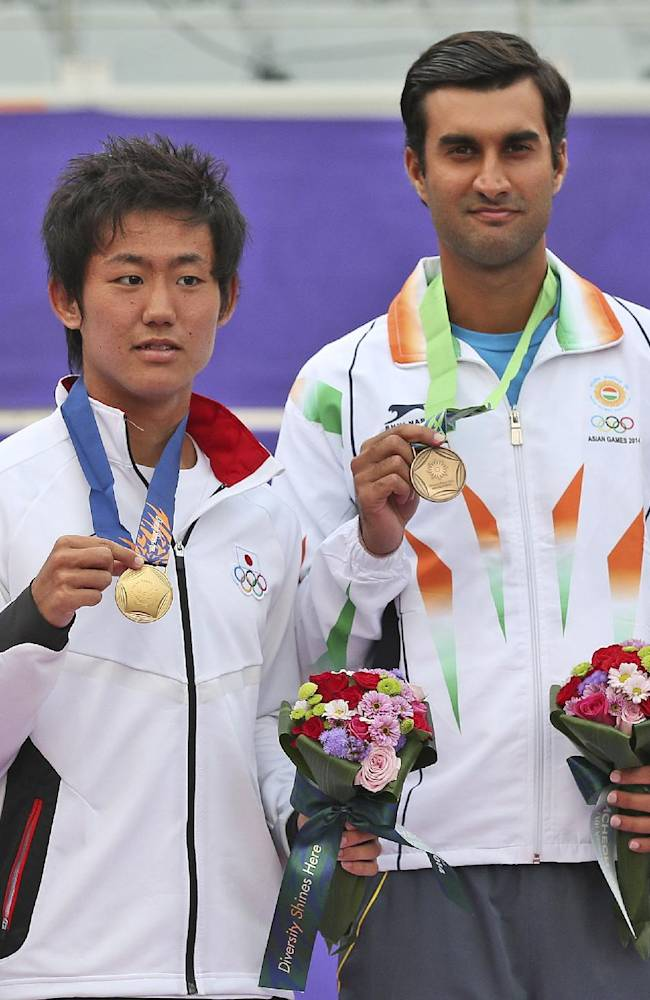 Medalists from left, Taipei's Yen Hsun silver, Japan's Yoshihito Nishioka gold, India's Yuki Bhambri bronze, and Japan's Yuichi Sugita bronze pose for a photo after the men's tennis final at the 17th Asian Games in Incheon, South Korea,  Tuesday, Sept. 30, 2014