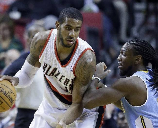 Portland Trail Blazers forward LaMarcus Aldridge, left, works the ball against Denver Nuggets forward Kenneth Faried during the first half of an NBA basketball game in Portland, Ore., Thursday, Jan. 23, 2014