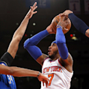 New York Knicks' Carmelo Anthony (7) shoots against Dallas Mavericks' Brandan Wright, left, and Shawn Marion during the first half of an NBA basketball game, Monday, Feb. 24, 2014, in New York The Associated Press