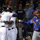 Atlanta Braves' Freddie Freeman, left, embraces teammate Justin Upton after Upton hit a two-run home run to score the pair in the third inning of a baseball game against the New York Mets, Thursday, April 10, 2014, in Atlanta The Associated Press
