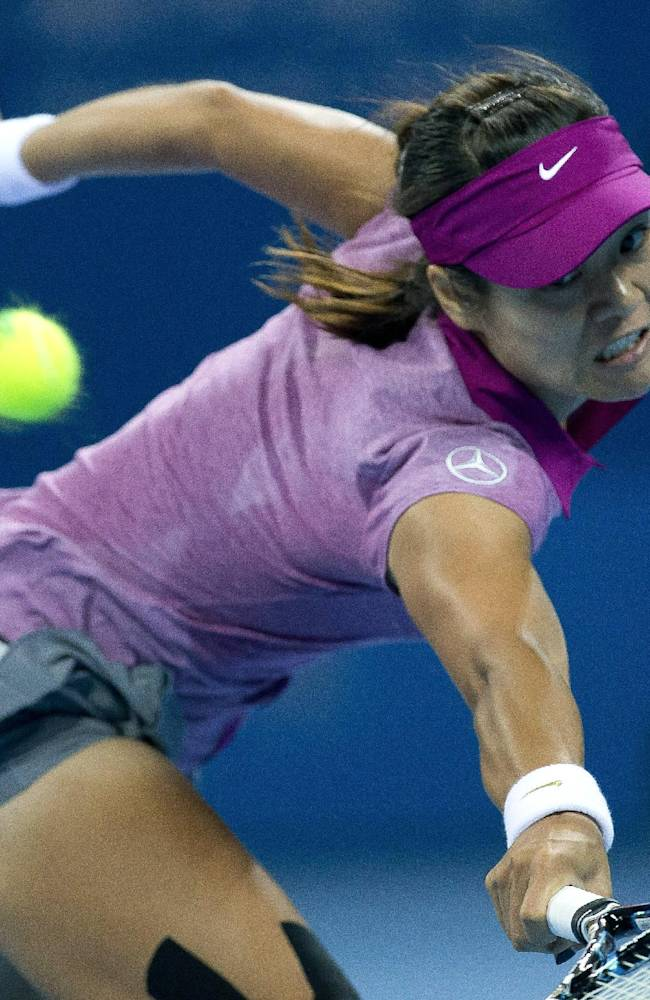 Li Na of China returns a shot against Sabine Lisicki of Germany during the China Open tennis tournament at the National Tennis Stadium in Beijing, China Wednesday, Oct. 2, 2013