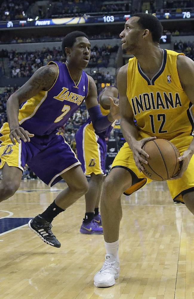 Indiana Pacers forward Evan Turner (12) looks to shoot in front of Los Angeles Lakers guard MarShon Brooks (2) during the second half of an NBA basketball game in Indianapolis, Tuesday, Feb. 25, 2014. The Pacers won 118-98