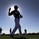 Los Angeles Dodgers pitcher Dan Haren throws during spring training baseball practice Tuesday, Feb. 11, 2014, in Glendale, Ariz The Associated Press