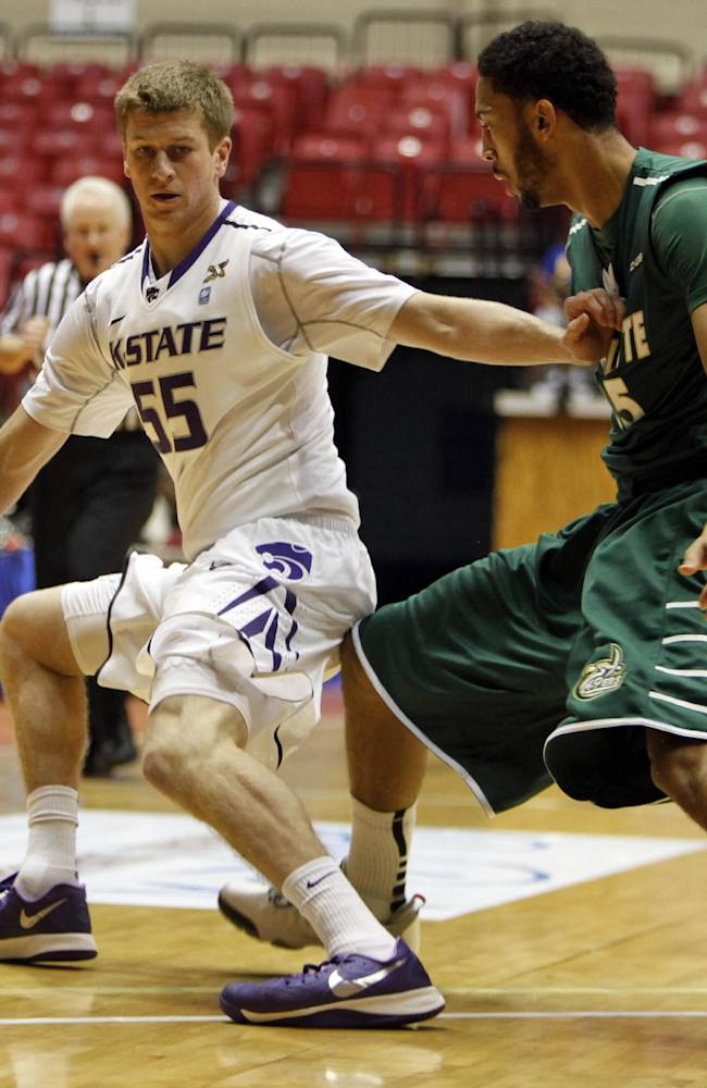 Kansas State guard Will Spradling, left, pushes away Charlotte's Pierria Henry during a NCAA college basketball game in San Juan, Puerto Rico, Thursday, Nov. 21, 2013
