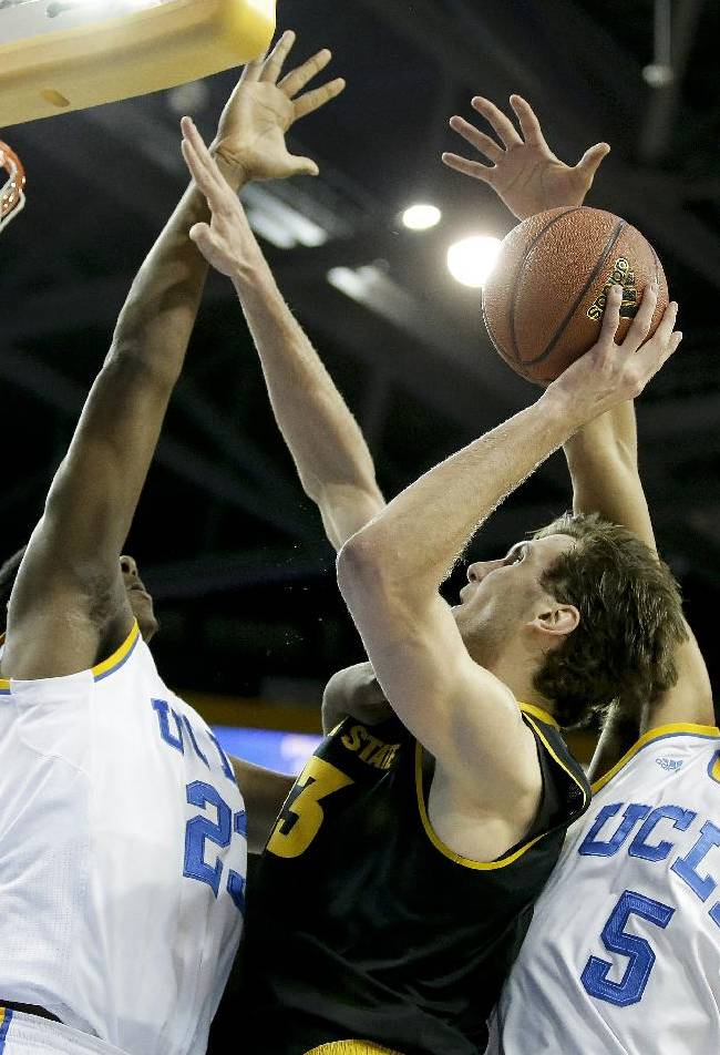 UCLA guard/forward Kyle Anderson, right, blocks a shot by Arizona State center Jordan Bachynski, center, with the help of Tony Parker during the first half of an NCAA college basketball game in Los Angeles, Sunday, Jan. 12, 2014
