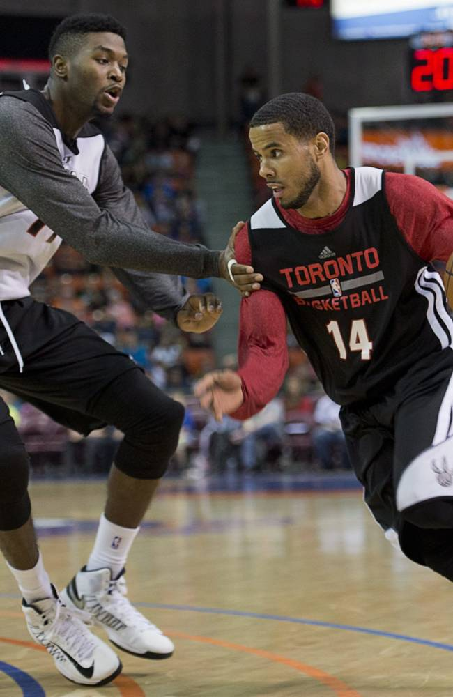 D.J. Augustin drives past Julyan Stone, left, during the Toronto Raptors intrasquad NBA basketball game in Halifax, Nova Scotia, on Saturday, Oct. 5, 2013